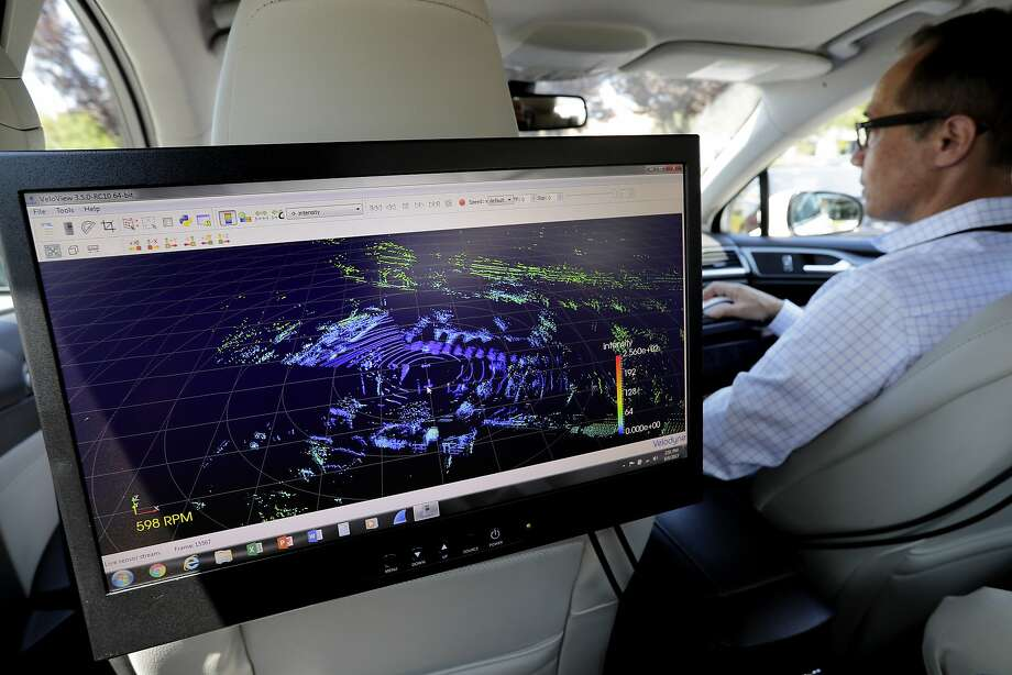 John Eggert, marketing manager at Velodyne, displays on a monitor what the lidar sensor is seeing as a test vehicle drives near the company in San Jose. Photo: Michael Macor, The Chronicle
