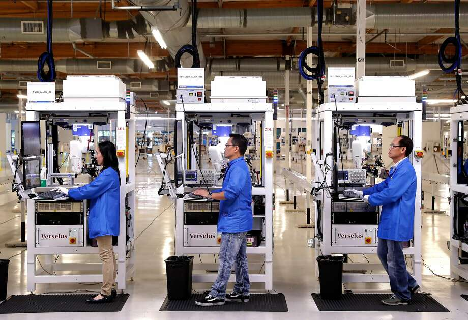 """Above: Velodyne is cranking up production in its San Jose mega-factory since it became the self-driving vehicle industry's go-to lidar supplier. Below: The laser-based sensor that lets cars """"see"""" their surroundings is displayed on a test vehicle. Photo: Michael Macor, The Chronicle"""