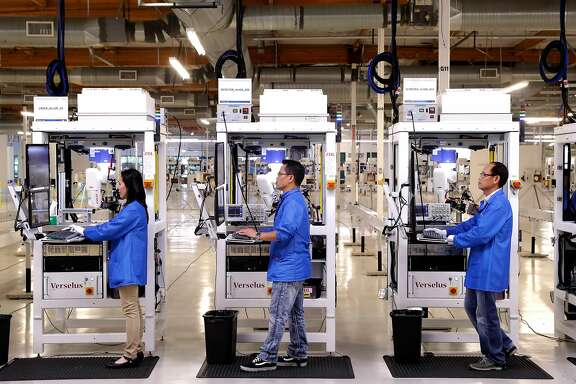 Working along the production line inside the factory at the headquarters of Velodyne in San Jose, Ca., on Tues. August 8, 2017. Velodyne is the leading developer of Lidar Sensors Autonomous Cars, Safety, & Mapping.