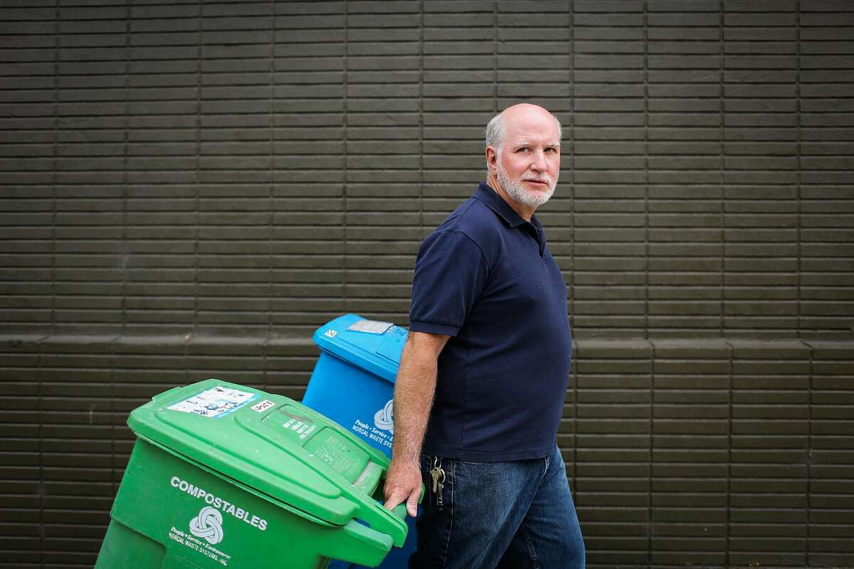 Chris Faust rolls his garbage bins during a portrait session in San Francisco, Calif., on Tuesday, Aug. 8, 2017.