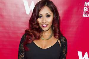 """FILE - In this May 29, 2014, file photo, Nicole """"Snooki"""" Polizzi attends WE tv's """"Marriage Boot Camp: Reality Stars"""" party in New York. New Jersey Gov. Chris Christie has signed legislation Monday, May 8, 2017, inspired by the former """"Jersey Shore"""" star Polizzi that limits how much state universities can pay speakers. (Photo by Charles Sykes/Invision/AP, File)"""