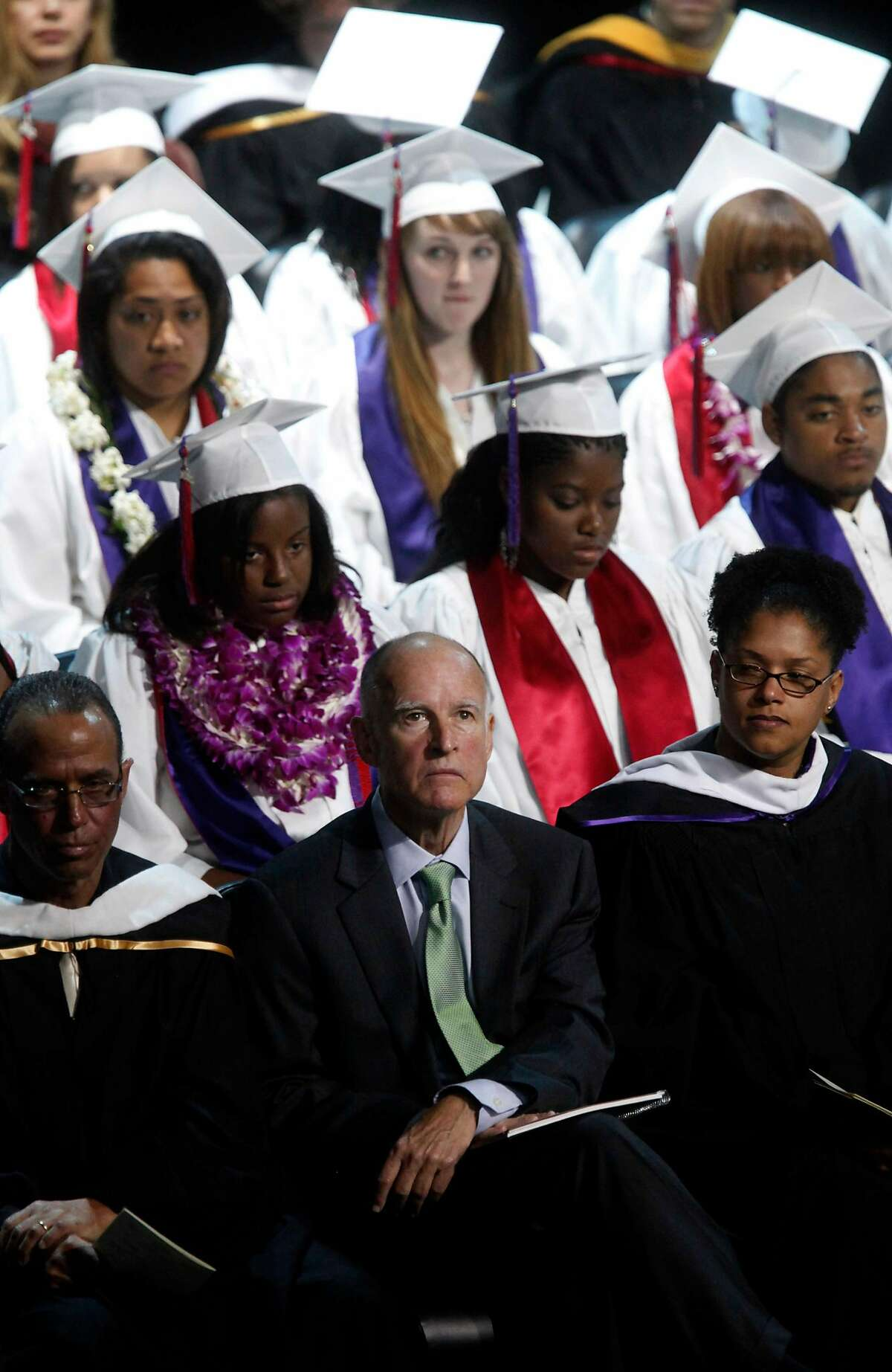 Attorney General and Gubernatorial candidate, Jerry Brown looks up after speaking at the Oakland School for the Arts graduation ceremony on Thursday June 17, 2010 in Oakland, Calif. Brown helped get the charter school off the ground years back is now being blamed by GOP nominee Meg Whitman for the demise of Oakland public schools.