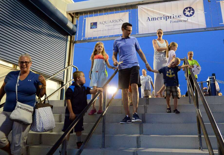Fans exit the Ballpark at Harbor Yard following a game between the Bridgeport Bluefish and the Somerset Patriots in 2014 Photo: Christian Abraham / File Photo / Connecticut Post