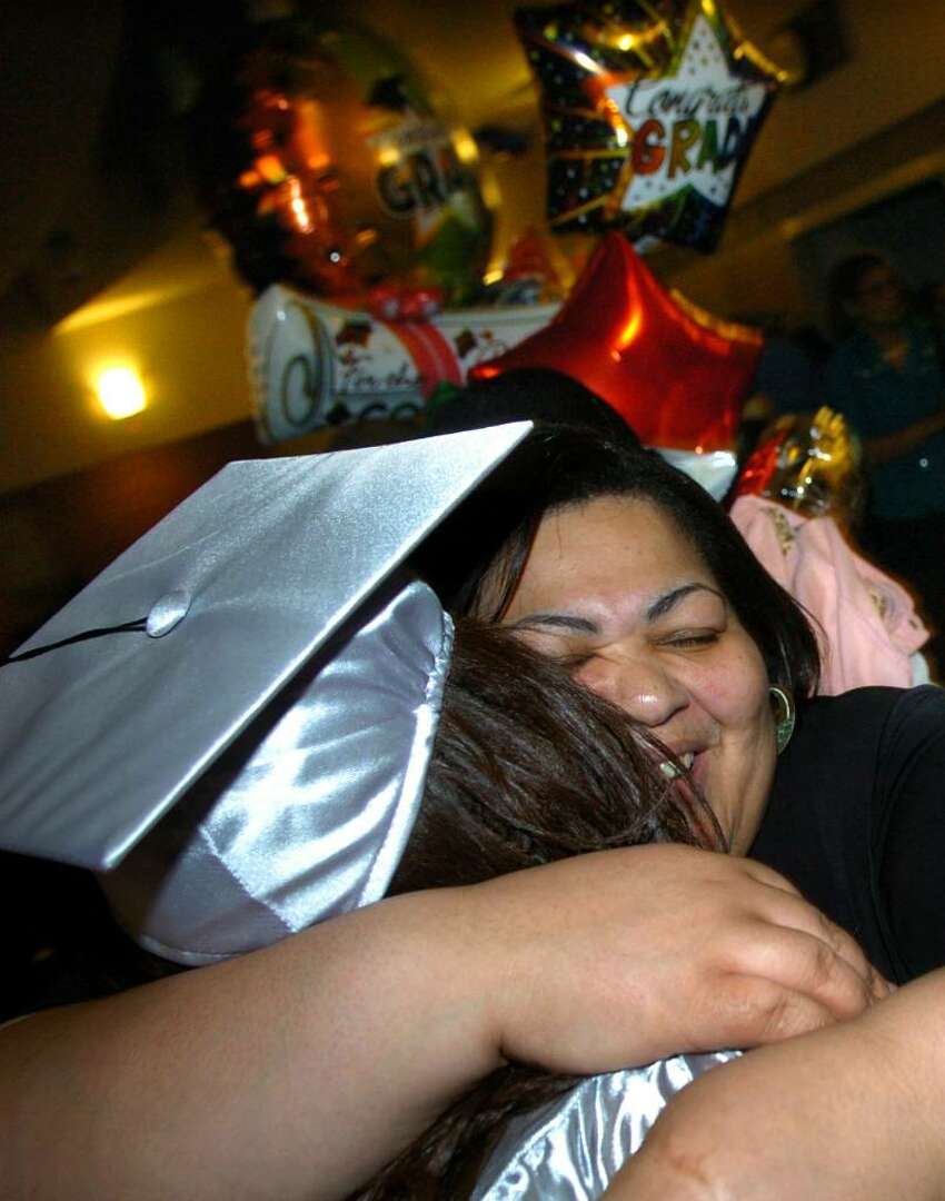 Barbara Jones hugs her daughter Tavarrea after graduating at Bridge Academy's 13th Annual Commencement Exercises held at Thurgood Marshall Middle School in Bridgeport, Conn. on Wednesday evening June 16, 2010.