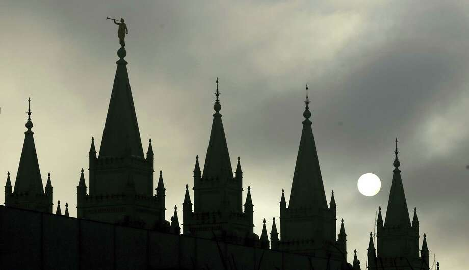 In this Feb. 6, 2013, file photo, the angel Moroni statue, silhouetted against a cloud-covered sky, sits atop the Salt Lake Temple, at Temple Square, in Salt Lake City. President Donald Trump's executive order temporarily banning refugees and nearly all travelers from seven Muslim-majority countries is raising concerns from the Mormon church, Gov. Gary Herbert and by hundreds of protesters marking the latest illustration of Utah's frosty relationship with Trump even though he carried the state. Photo: AP Photo/Rick Bowmer, File   / Copyright 2017 The Associated Press. All rights reserved.