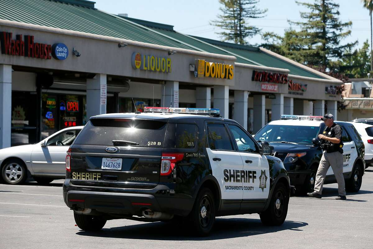 Sacramento County sheriff�s officers are seen at he Auburn Boulevard strip mall, located across the street from Sacramento County�s Centralized Placement Support Unit, includes a smoke shop, two massage parlors, a liquor store and a gun dealer.