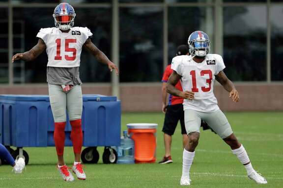 New York Giants wide receiver Brandon Marshall (15) and wide receiver Odell Beckham (13) work out during NFL football training camp, Tuesday, Aug. 8, 2017, in East Rutherford, N.J. (AP Photo/Julio Cortez)