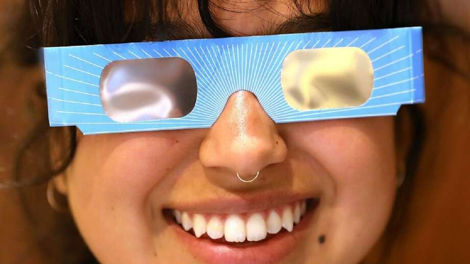 Photo: Warby Parker Employee Karolyna Landin Poses With A Pair Of Solar Eclipse Glasses That The Eyeglass Store Is Giving Out For Free On August 11, 2017 In New York City. To View The Upcoming Total Solar Eclipse On August 21 Eye Protection Is Essential. The Des