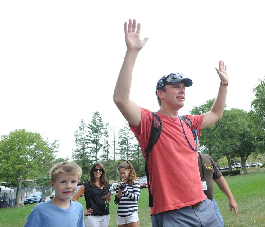 With his son Owen, 8, by his side, U.S. Senator Chris Murphy (D-Conn.) raises his arms as greets the crowd gathered at Roger Sherman Baldwin Park in Greenwich, Conn., Saturday morning, Sept. 3, 2016. Senator Murphy held a town meeting in the park that marked the end of a 130-mile walk across Connecticut to listen to and get feedback from state residents. Murphy was joined by his family on the Greenwich leg of his trek. Senator Murphy started his walk on Monday in Voluntown, Conn., on the Rhode Island border. Photo: Bob Luckey Jr. / Hearst Connecticut Media / Greenwich Time