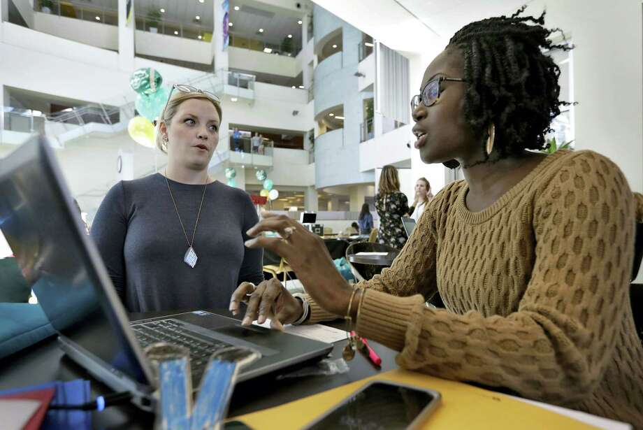 Xonjenese Jacobs, right, helps Kristen Niemi sign up for the Affordable Care Act during a healthcare expo at the University of South Florida on Jan. 24, 2017 in Tampa, Fla. Photo: AP Photo/Chris O'Meara  / Copyright 2017 The Associated Press. All rights reserved.