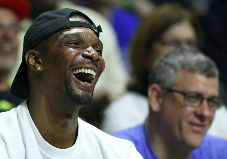 Miami Heat forward Chris Bosh smiles during the first half of an NCAA college basketball game between Miami and Duke in Coral Gables, Fla., on Feb. 25, 2017. Photo: David Santiago — El Nuevo Herald Via AP  / El Nuevo Herald