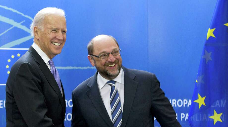 U.S. Vice President Joe Biden, left, is greeted by European Parliament President Martin Schultz at the European Parliament in Brussels on Feb. 6, 2015. Photo: The Associated Press, File  / AP