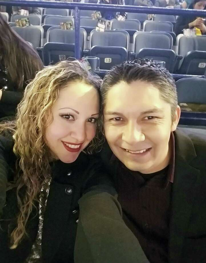 This Dec. 4, 2016, photo provided by Elizabeth Hernandez shows Elizabeth with her husband, Juan Carlos Hernandez Pacheco, at a concert in Chicago. Pacheco, who has been the manager of La Fiesta Mexican Restaurant in West Frankfort, Ill., for a decade was arrested Feb. 9, 2017, by Immigration Customs and Enforcement officials and has been detained at an ICE facility in St. Louis. Pacheco came to the U.S. in the 1990s but didn't obtain legal status.The southern Illinois community that solidly backed President Donald Trump is rallying behind Pacheco, who doesn't have legal permission to live in the U.S. Town residents are writing letters in support, including the mayor and police chief. They deem Hernandez a role model, praising his robust civic involvement. Photo: Elizabeth Hernandez Via AP   / Elizabeth Hernandez