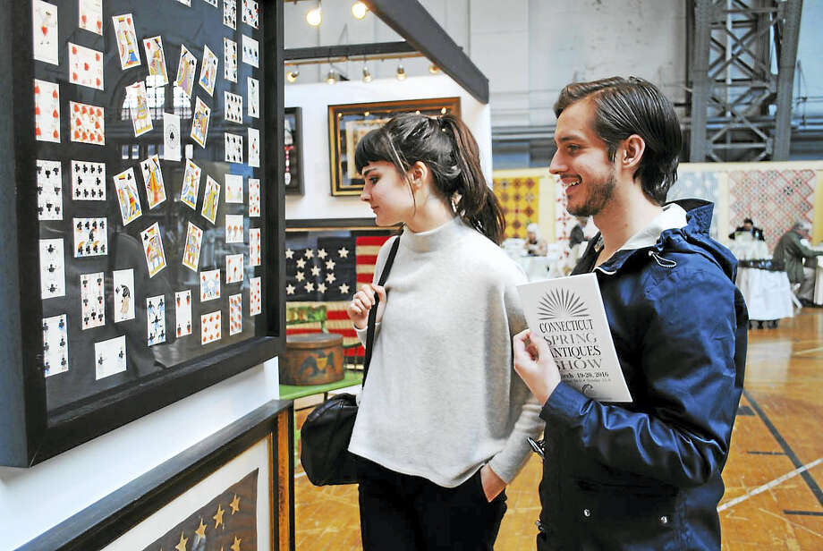 Guests look at an exhibit at the Connecticut Spring Antiques Show at the Hartford Armory. Photo: Contributed Photo
