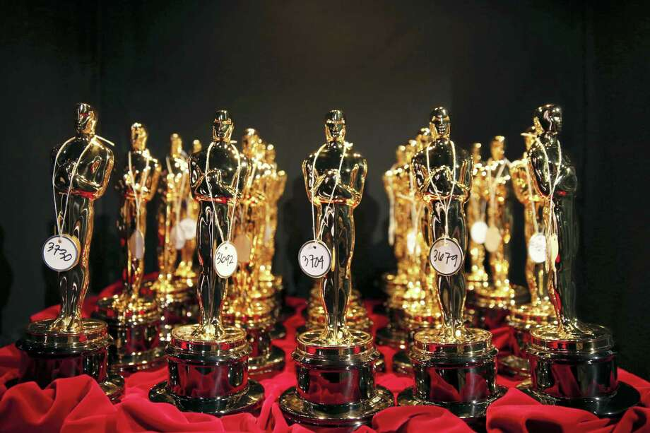 This March 2, 2014, file photo shows Oscar statues lined up backstage during the Oscars in Los Angeles. Photo: Photo By Matt Sayles/Invision/AP, File  / Invision