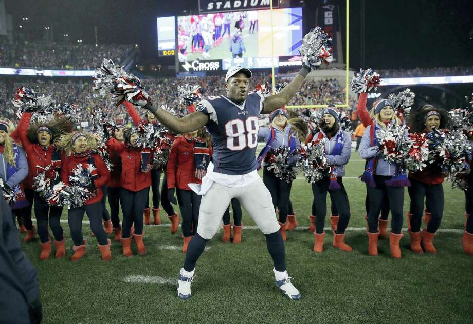 Patriots tight end Martellus Bennett celebrates with cheerleaders after the AFC championship game. Photo: Charles Krupa — The Associated Press  / Copyright 2017 The Associated Press. All rights reserved.
