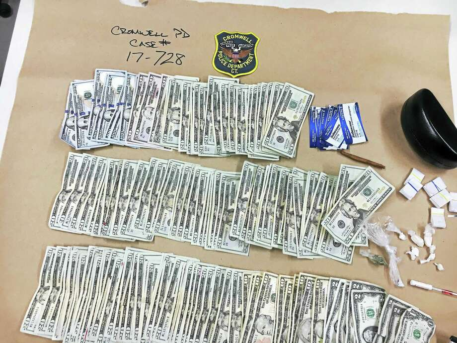 Cromwell detectives claim they confiscated 60 bags of heroin, eight packages of crack cocaine, Percocet pills, eight packages of Suboxone and $3,577 in cash after pulling over a Hartford man for driving inconsistently on Main Street Saturday afternoon. Photo: Courtesy Cromwell Police