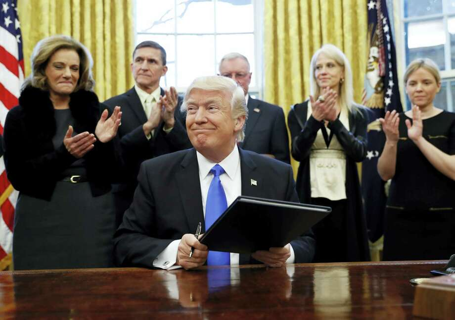 President Donald Trump smiles after signing an executive action in the Oval Office, Saturday in Washington. Photo: Alex Brandon — The Associated Press  / Copyright 2017 The Associated Press. All rights reserved.