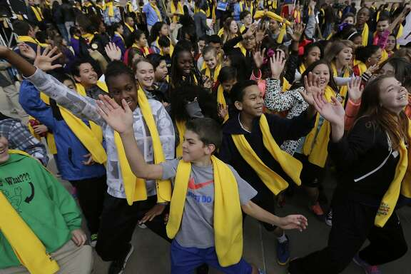 Students dance in front of the Texas Capitol during a school choice rally, Friday, Jan. 30, 2015, in Austin, Texas. School choice supporters called for expanding voucher programs and charter schools statewide. (AP Photo/Eric Gay)