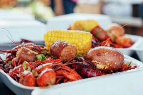 Pinch Boil House and Bia Bar will serve Southeast Asian-inspired dishes like this plate of crawfish in garlic butter sauce when it opens at 124 N. Main St. later this summer.