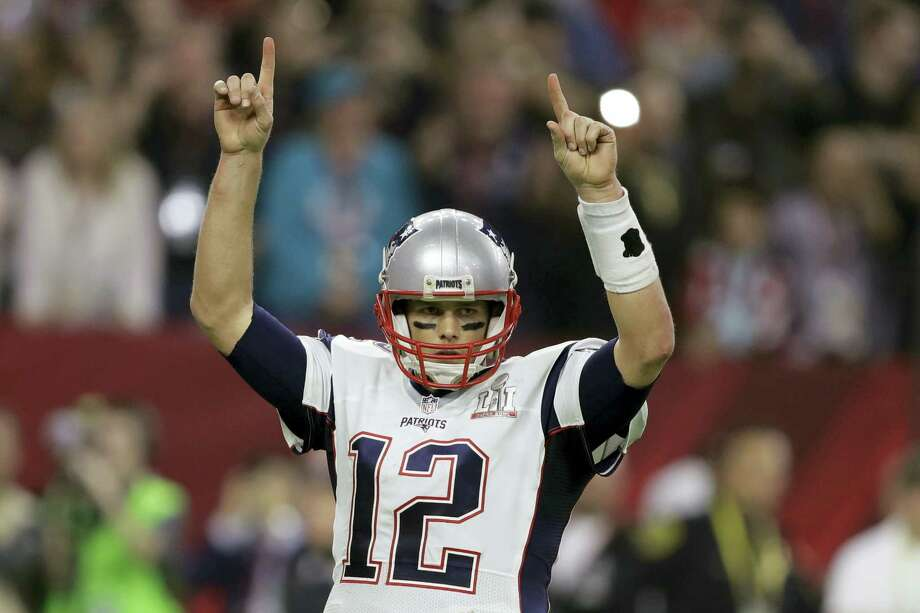 New England Patriots player Tom Brady raises his arms after a touchdown, during the second half of the NFL Super Bowl 51 football game against the Atlanta Falcons Feb. 5 in Houston. Photo: Darron Cummings — The Associated Press  / Copyright 2017 The Associated Press. All rights reserved.