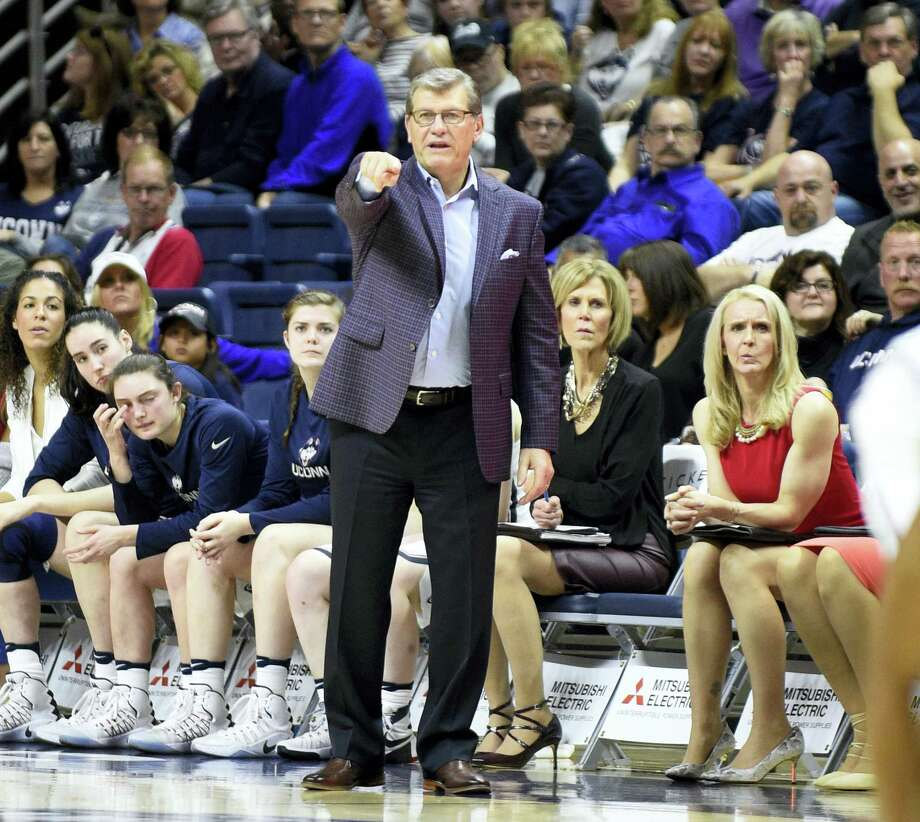 UConn coach Geno Auriemma signals to his team during Saturday's win over Memphis. Photo: The Associated Press File Photo  / FR153656 AP