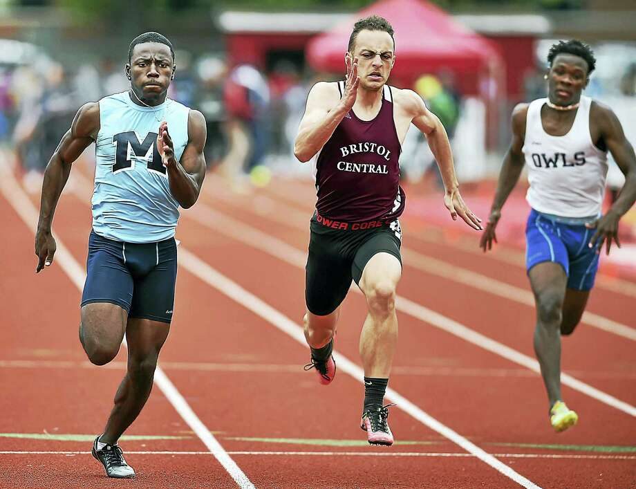 Middletown's DeShaun Bradshaw wins the 100 meter dash in 11.24 at the Class L track & field championships, Tuesday, May 30, 2017, at Manchester High School. Middletown High School finished first with 80 points edging out Daniel Hand 77.50. Photo: Catherine Avalone - New Haven Register  / Catherine Avalone/New Haven Register