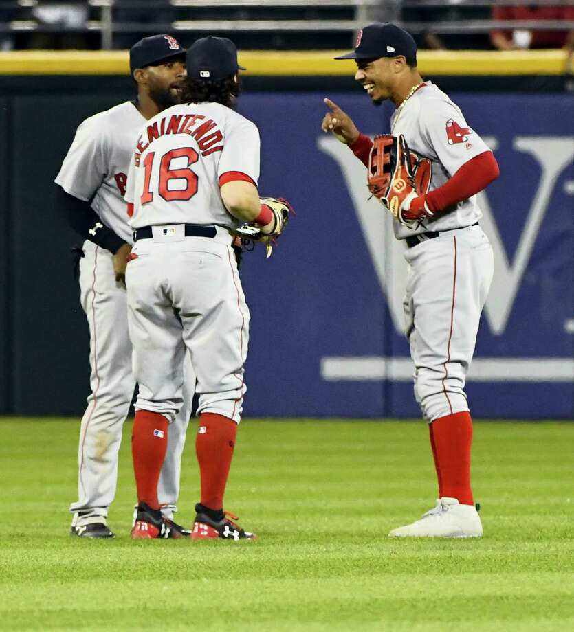 Boston Red Sox center fielder Jackie Bradley Jr., left, left fielder Andrew Benintendi (16) and right fielder Mookie Betts after celebrate after the Red Sox defeated the Chicago White Sox 4-1  in Chicago on Wednesday. Photo: Matt Marton — The Associated Press  / FR170980 AP