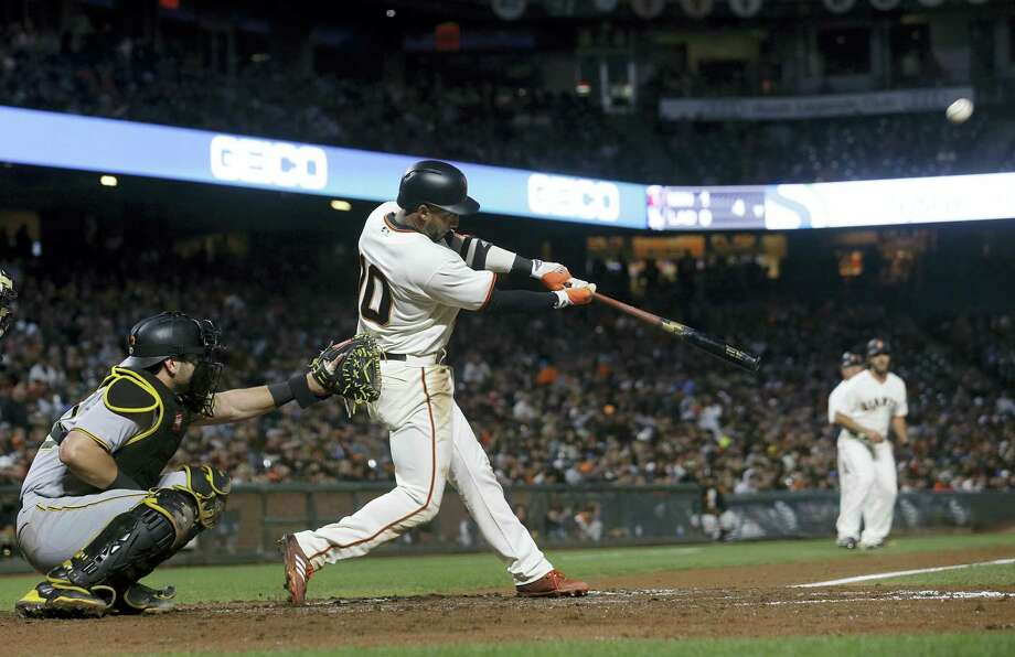 San Francisco Giants' Eduardo Nunez hits a two-run double in front of Pittsburgh Pirates catcher Francisco Cervelli during the fourth inning of a baseball game in San Francisco on July 25, 2017. Photo: AP Photo — Jeff Chiu  / Copyright 2017 The Associated Press. All rights reserved.