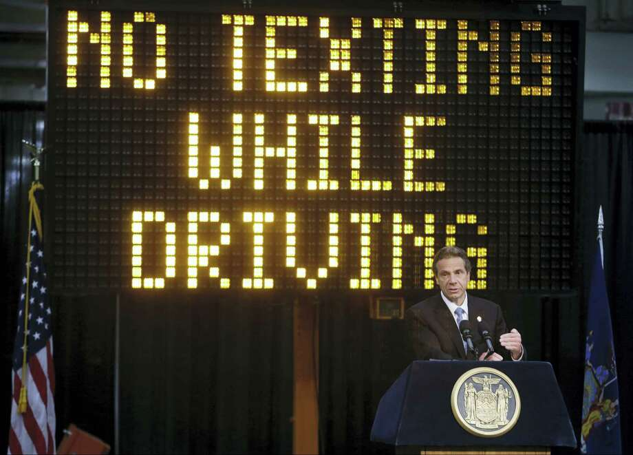 """In this May 31, 2013, file photo, New York Gov. Andrew Cuomo speaks during a news conference to announce the increase in penalties for texting while driving in New York. New York state is set to study the use of a device known as the """"textalyzer"""" that would allow police to determine whether a motorist involved in a serious crash was texting while driving. Cuomo announced Wednesday, July 26, 2017, that he would direct the Governor's Traffic Safety Committee to examine the technology, as well as the privacy and constitutional questions it could raise. Photo: AP Photo/Frank Franklin II, File   / Copyright 2017 The Associated Press. All rights reserved."""