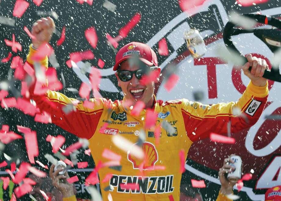 Joey Logano celebrates after winning the NASCAR Cup Series auto race in Victory Lane at Richmond International Raceway in Richmond, Va., Sunday. Photo: Steve Helber - The Associated Press  / Copyright 2017 The Associated Press. All rights reserved.