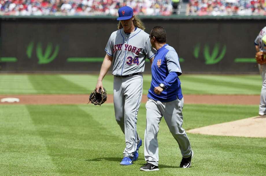 New York Mets starting pitcher Noah Syndergaard leaves the game with an injury during the second inning against the Washington Nationals Sunday. Syndergaard will have an MRI. Photo: NICK WASS - THE ASSOCIATED PRESS  / FR67404 AP