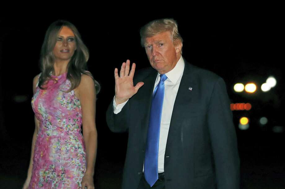 President Donald Trump waves as he walks with first lady Melania Trump away from Marine One after arriving on the South Lawn of the White House in Washington on July 25, 2017, returning from Ohio. Photo: AP Photo — Alex Brandon  / Copyright 2017 The Associated Press. All rights reserved.