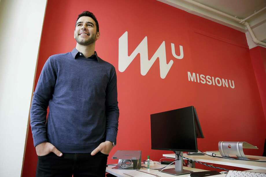In this photo taken April 27, 2017, founder Adam Braun poses at MissionU in San Francisco. MissionU, which began accepting its first applications last month, offers a one-year program in data analytics and business intelligence with an upfront tuition of $0. As part of a profit-sharing agreement, MissionU students will be giving back 15 percent of their salary for three years after graduation, given that they make at least $50,000 per year. Photo: AP Photo — Eric Risberg  / Copyright 2017 The Associated Press. All rights reserved.