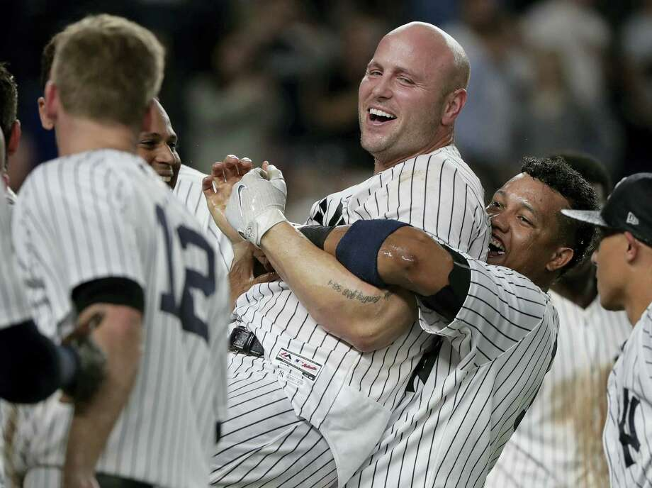 New York Yankees' Starlin Castro, right, hugs Matt Holliday after Holliday hit a three-run home rung during the tenth inning of a baseball game to beat the Baltimore Orioles, Friday, April 28, 2017, in New York. (AP Photo/Julie Jacobson) Photo: AP / Copyright 2017 The Associated Press. All rights reserved.