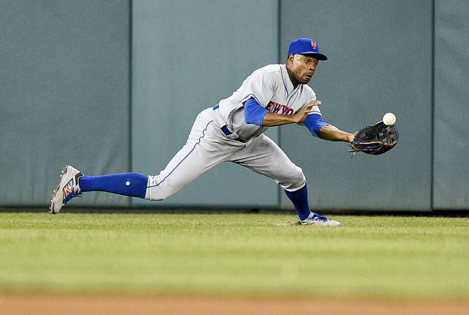 New York Mets center fielder Curtis Granderson makes a catch on a drive by Washington Nationals' Wilmer Difo for the out during the seventh inning of a baseball game, Friday, April 28, 2017, in Washington. (AP Photo/Nick Wass) Photo: AP / FR67404 AP