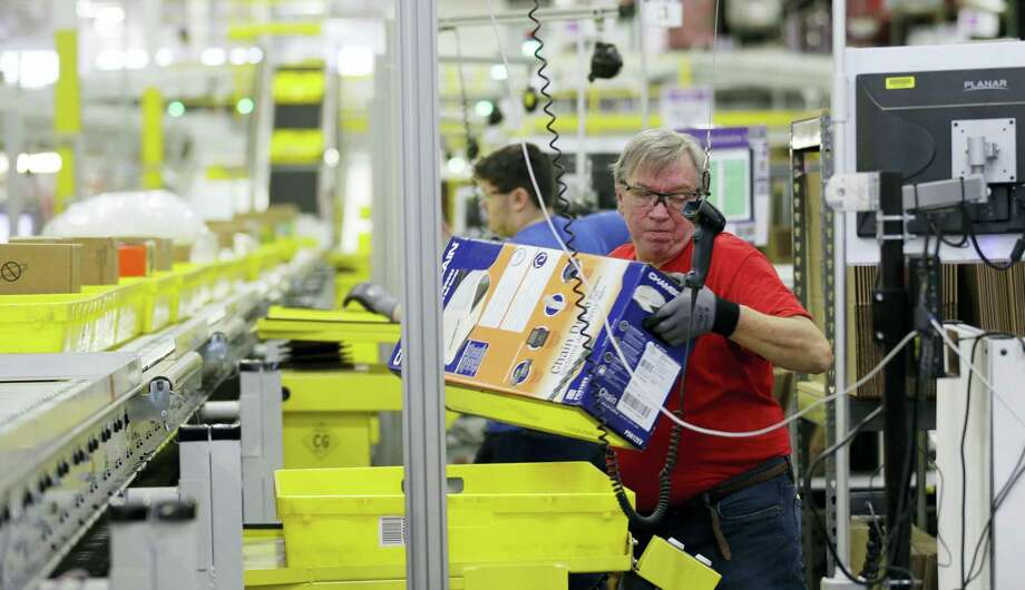 Mark Oldenburg processes outgoing orders at Amazon.com's fulfillment center in DuPont, Wash. Photo: Ted S. Warren / The Associated Press File  / Copyright 2016 The Associated Press. All rights reserved. This material may not be published, broadcast, rewritten or redistribu