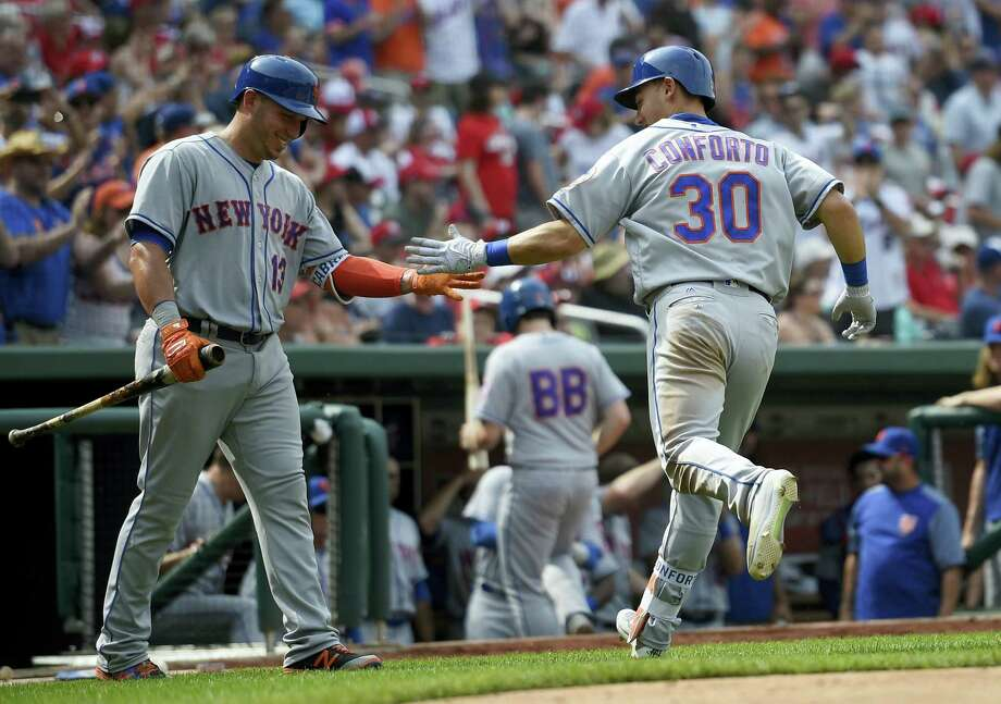 New York Mets' Michael Conforto (30) celebrates his home run with Asdrubal Cabrera (13) during the eighth inning of a baseball game against the Washington Nationals, Saturday in Washington. The Mets won 5-3. Photo: Nick Wass — The Associated Press  / FR67404 AP