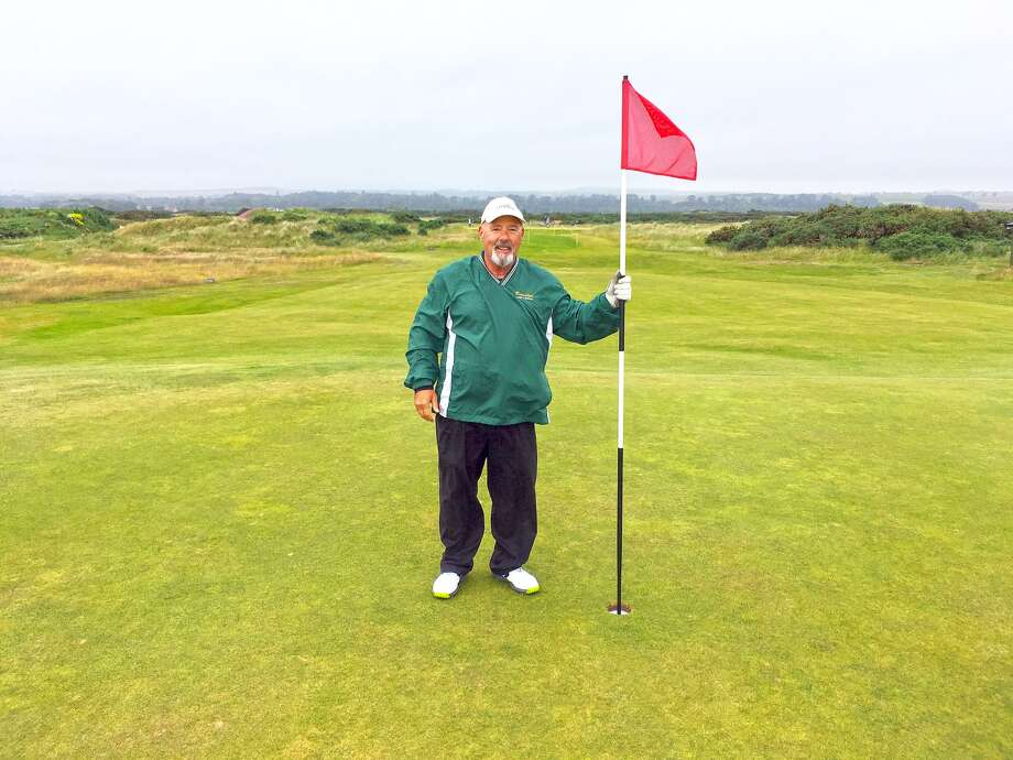 Lifelong Edwardsville resident Richard Holliday poses on Hole No. 13 at the New Course at St. Andrews after hitting a hole-in-one on July 19 in Scotland.