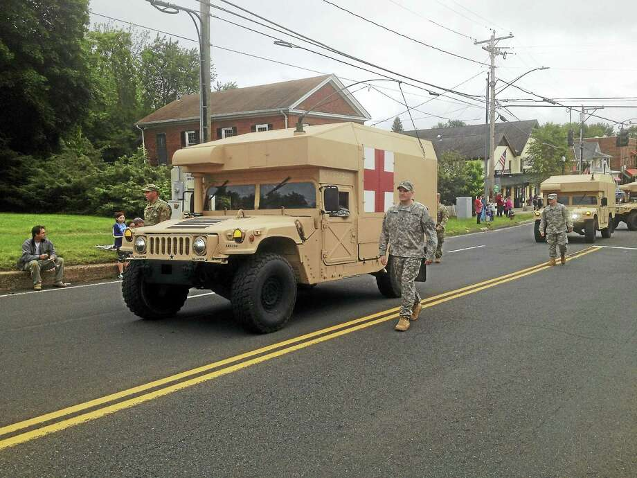 "At Cromwell's Memorial Day parade Tuesday evening, American Legion Post Commander Louis Gagnon urged those gathered: ""Do not take our freedom for granted. Its price is too well-known. All you have to do is look around."" Photo: Jeff Mill — The Middletown Press"