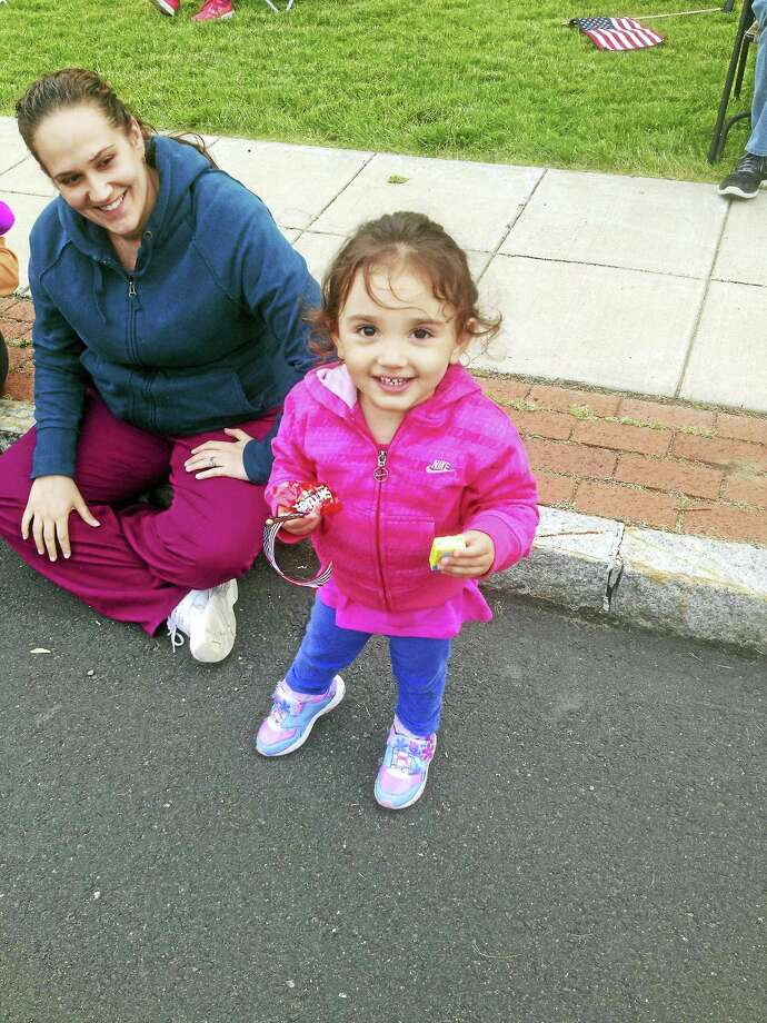 Families enjoyed Cromwell's Memorial Day parade Tuesday evening. Photo: Jeff Mill — The Middletown Press