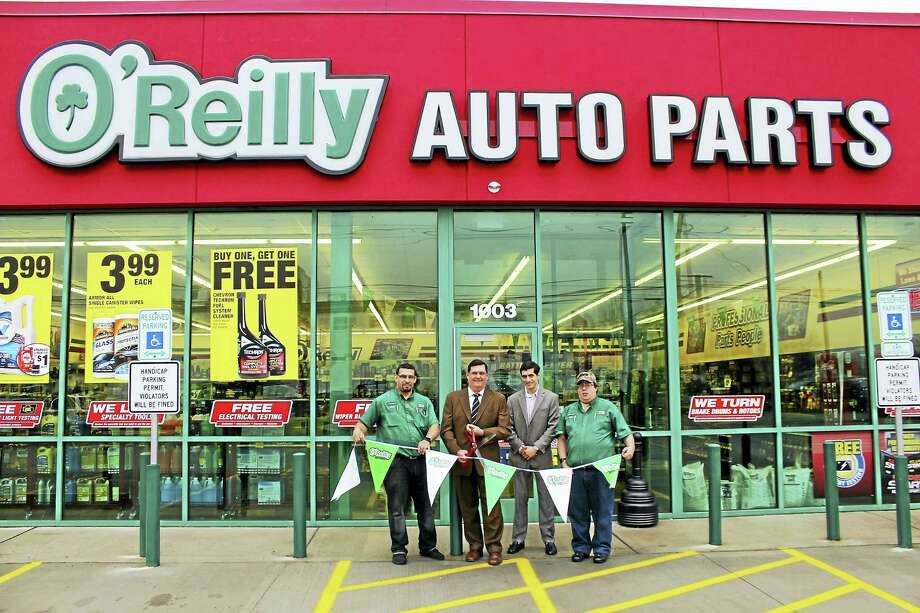 O'Reilly Auto Parts opens on Route 1: Mayor Edward M. O'Brien, holding a pair of oversize scissors, cuts the ribbon April 21 to mark the ceremonial opening of O'Reilly Auto Parts, a chain specializing in automotive parts and accessories, at 1003 Boston Post Road. From left are store manager Jose Cotto Maldonado; state Rep. Michael A. DiMassa, D-West Haven; and assistant store manager Rob Sabia. The Route 1 store, built on the former site of Chuck's Steakhouse, is open from 7:30 a.m. to 9 p.m. Monday-Saturday and 9 a.m. to 8 p.m. Sunday. The company, headquartered in Springfield, Missouri, has more than 4,500 stores nationwide. Photo: CONTRIBUTED PHOTO — Michael P. Walsh/City Photo