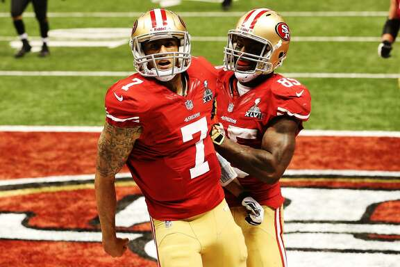 NEW ORLEANS, LA - FEBRUARY 03:  (L-R) Colin Kaepernick #7 and Vernon Davis #85 of the San Francisco 49ers celebrate after Kaepernick scored a 15-yard rushing touchdown in the fourth quarter against the Baltimore Ravens during Super Bowl XLVII at the Mercedes-Benz Superdome on February 3, 2013 in New Orleans, Louisiana.  (Photo by Ronald Martinez/Getty Images)