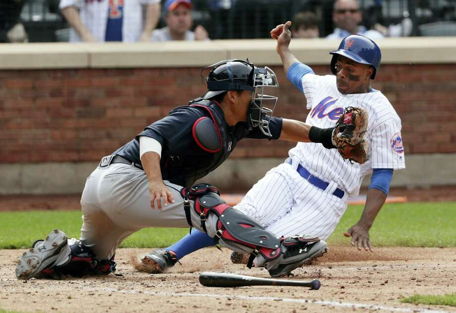 New York Mets' Curtis Granderson (3) slides past Atlanta Braves catcher Kurt Suzuki to score during the ninth inning of a baseball game Thursday, April 27, 2017, in New York. The Braves won 7-5. (AP Photo/Frank Franklin II) Photo: AP / Copyright 2017 The Associated Press. All rights reserved.