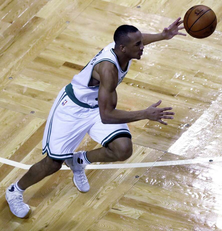 Boston Celtics guard Avery Bradley (0) dribbles down court during the fourth quarter of a first-round NBA playoff basketball game in Boston, Wednesday. The Celtics defeated the Bulls 108-97. Photo: Charles Krupa - The Associated Press  / AP
