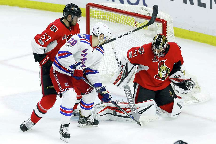 Ottawa Senators goalie Craig Anderson (41) makes a save as defenseman Ben Harpur (67) and New York Rangers left wing Chris Kreider (20) look for the rebound during the third period of Game 1 of an NHL hockey second-round playoff series, Thursday in Ottawa, Ontario. Photo: Fred Chartrand - The Associated Press  / The Canadian Press