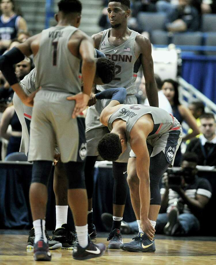 UConn's Jalen Adams holds his ankle after getting injured in the first half on Saturday. Photo: Jessica Hill — The Associated Press  / AP2017