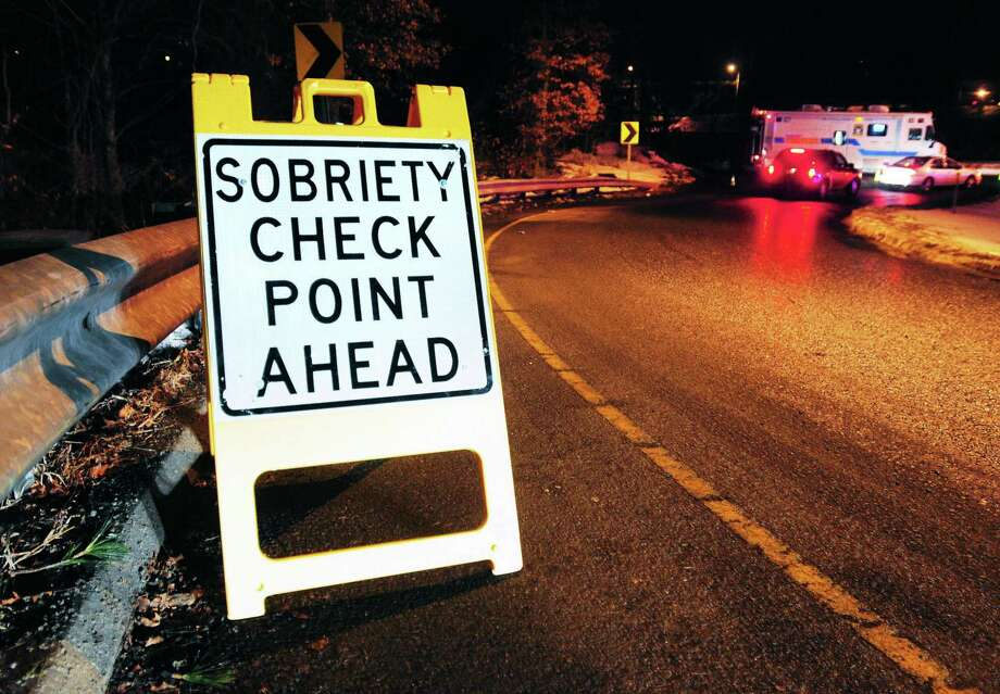 (Arnold Gold — New Haven Register)  A sign alerts motorists to a sobriety check point at the entrance to I-95 off of Willow St. in New Haven on 12/20/2013. Photo: Journal Register Co.