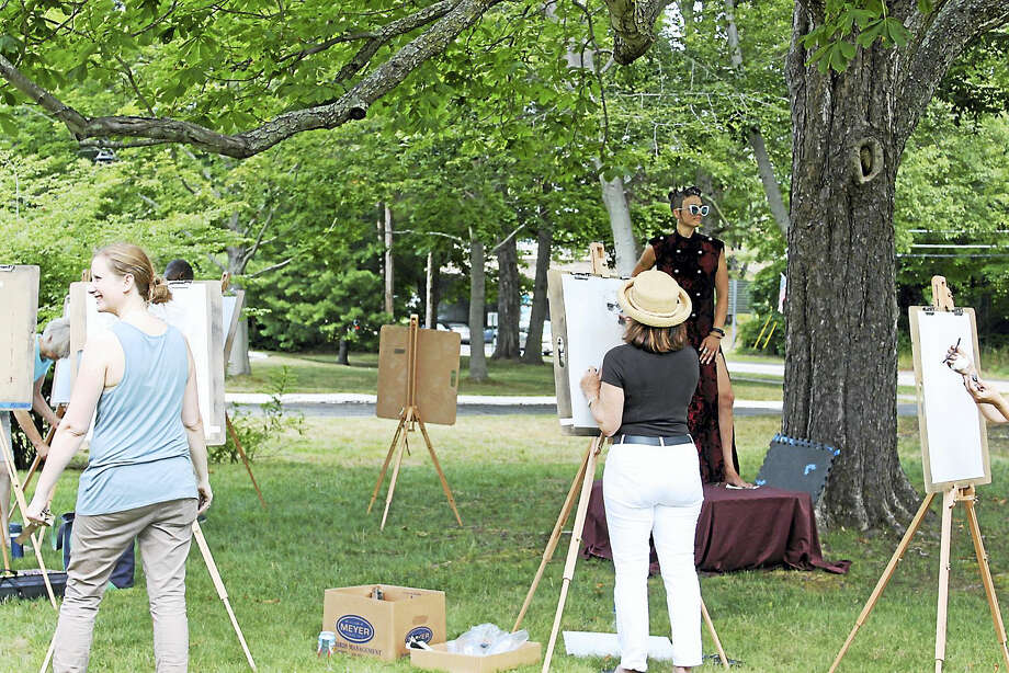 "Artists from the Lyme Academy paint ""en plein air"" during the Old Lyme Midsummer Festival, which will be held in Old Lyme on Friday and Saturday. Photo: Contributed Photos"