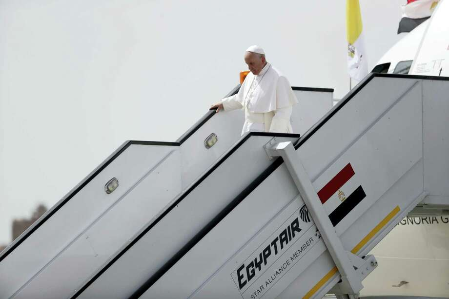 Pope Francis walks down the steps of the airplane upon arriving at Cairo's airport, Egypt, Friday, April 28, 2017. Francis is in Egypt for a two-day trip aimed at presenting a united Christian-Muslim front that repudiates violence committed in God's name. Photo: AP Photo/Gregorio Borgia   / Copyright 2017 The Associated Press. All rights reserved.